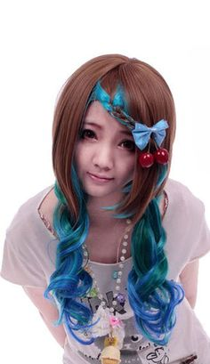 Natural style wig with an unusual mermaid feel. Cut in a layered style with flouncy curls and long bangs. Aqua colours of blues, turquoise and greens overlaid in strawberry blonde. The wig comes with a hair net and is fully lined with adjustable strap for added comfort whilst wearing. Wig is not shiney.