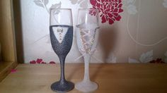 A glamorous and personal way to toast your wedding, a gift for the couple on their wedding day. This beautiful handmade set of two champagne glasses are decorated with a sparkling glitter featuring a ribbon corset back and edged with rhinestones .  Groom is in charcoal grey and the bride corset detail is light pink. I can make matching groomsmen and bridesmaids glasses and custom orders are welcome - these glasses can be made in various color combinations, just ask and Ill do my best to…