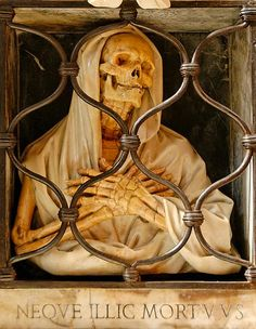 Gian Battista Gisleni's grave in church Santa Maria del Popolo in Rome in the form of a memento mori, showing an intricately carved skeleton figure of Death.