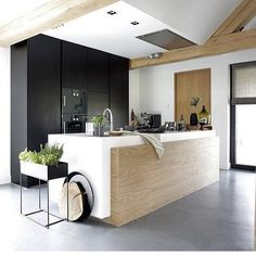 Contemporary kitchen with full flat surfaces and a monolithic island
