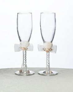 These two Seaside Ivory Wedding Toasting Flutes 8 Inches toasting glasses are perfect for weddings with a fun beach theme. Each glass is decorated with a white sheer bow and cluster of seashells. Decoration is removable Wedding Toasting Glasses, Wedding Flutes, Toasting Flutes, Champagne Glasses, Wedding Champagne, Seashell Wedding, Ivory Wedding, Wedding Cake, Wedding Gifts