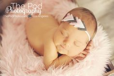 Pink and gray newborn baby girl in pink fur and headband www.ThePodPhoto.com