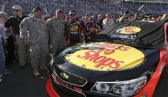 PHOTOS: Tony Stewart poses with a couple of soldiers before the start of the Coca-Cola 600 at Charlotte. View more photos from the Coke 600 here: www.stewarthaasra...