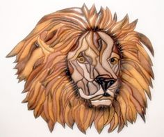 """Male lion head, of pine, with acrylic paint and clear satin finish. Size is 19"""" x 18"""" and is 179 pieces. We mention the number of pieces that make up the finished product, so everyone can see how much work goes into each creation. All of the pieces are glued together making the beautiful finish product that you are looking at.We will custom quote the shipping for anyplace in the world on any specific item. #zibbet"""