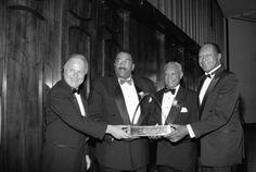 Richard Riordan, Willie Williams, John Mack, and Tom Bradley hold an award. Photo by Guy Crowder.