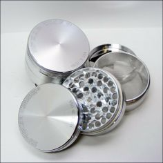 """SPACE CASE Grinder Sifter Mag. 4 Pc. Medium . $59.00. If you're unfamiliar with the world of grinding, you're in for a treat! Because grinding exposes the maximum surface area, it makes the material much more potent during use, allowing it to be utilized much more efficiently. Airtight, portable, and polished to a flawless mirror finish.   Triangle collector included.   Specs: Medium= 2 1/2"""" diameter X 2"""" tall"""