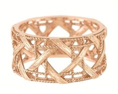 I would buy this gorgeous rose gold Dior ring by designer Victoire de Castellane