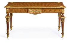 An important pair of Royal Victorian gilt-bronze mounted tulipwood, yewwood, amboyna, harewood, and ivory marquetry center tables London, circa 1870, by Holland & Sons