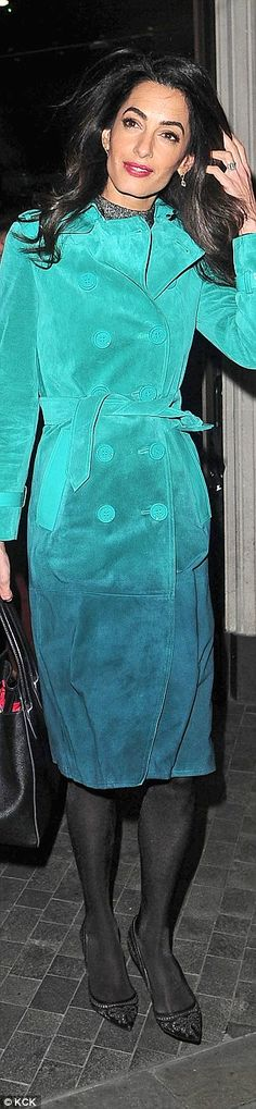 Wearing a £3000 suede turquoise Burberry Prorsium ternch out to dinner...