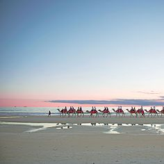 Tourists ride camels along Cable Beach, near the coastal town of Broome, the gateway to Western Australia's Kimberly Coast. | Coastalliving.com