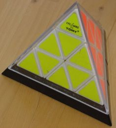Pyraminx, Rubix Cube knock-off by Tomy Keith had this. I could never do it.