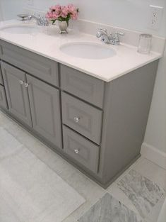 Painted gray vanity... great idea if a house comes with that awful light brown wooden cabinets.