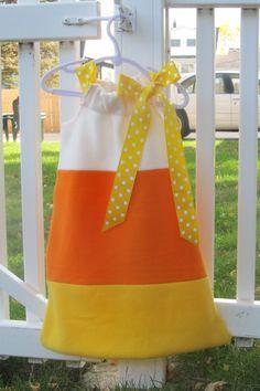 Easy candy corn costume Or Yellow skirt, orange scarf around the waist, white shirt....