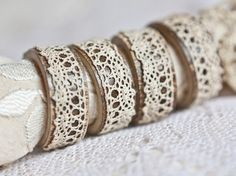 Napkin rings from wooden rings and vintage lace...perfection