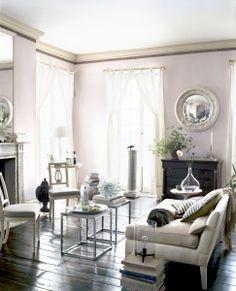 metal mirror. black floor. white. almost pink paint