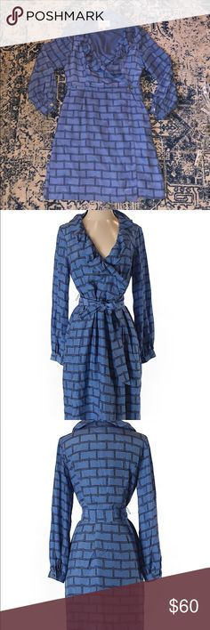 Elizabeth McKay 100% silk wrap dress Excellent condition. Smoke free home.  Beautiful spring blue color!  Ruffle detail at the neck. Wrap style. Comes with 2 belts - a sash that can be tied as tight as you like or good-button belt.   Measurements included in pics Elizabeth McKay Dresses Long Sleeve