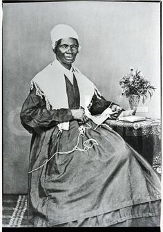 Sojourner Truth poses for a portrait while knitting at a small table. Sojourner Truth, whose legal name was Isabella Van Wagener, was born into slavery but later freed. She worked as an abolitionist, a suffragette, and an evangelist and traveled throughout the Midwest drawing large crowds.