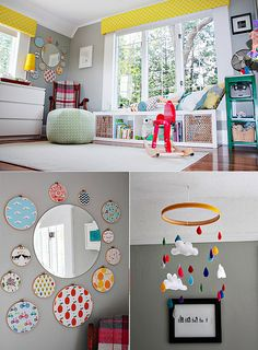 embroidered circles with stories around mirror, nice bench under window with baskets for toys and colorful pillows on top