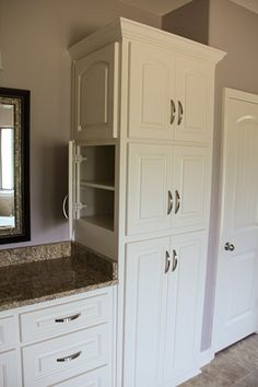 Bathroom cabinet idea Gary wants the linen closet by sink to open on side like this picture. Painting Bathroom Cabinets, Bathroom Mirror Cabinet, Bathroom Flooring, Bathroom Furniture, Cabinet Closet, Bathroom Wallpaper, Bathroom Interior, Bathroom Renos, Small Bathroom