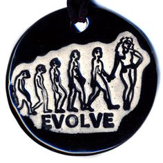 Evolution of Man with Woman Ceramic Necklace in Black by surly, $20.00