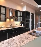 Galley Kitchen with White Granite Counter with Dark Cabinetry | Cultivate