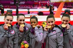Jul 31, 2012; London, United Kingdom; USA team members (L-R) McKayla Maroney - Jordyn Wieber - Gabrielle Douglas - Alexandra Raisman - Kyla Ross bite their gold medals after the women's team gymnastics final during the London 2012 Olympic Games at North Greenwich Arena.