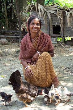 Woman and her livestock, Bangladesh