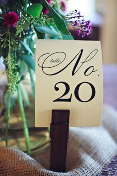 Table numbers // Photo by j.woodbery photography, via http://theeverylastdetail.com/2013/10/09/fall-purple-champagne-alabama-wedding/