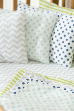 Baby sheets and pillows in polkat dots, lime stripes and chevron http://en.atelieredele.com/