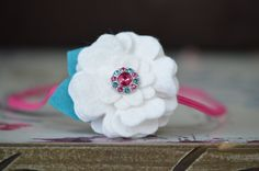 White Wool Flower Hair Band . Baby Felt Flower Headband . With Fuchsia and Turquoise Rhinestone Button . Photography Prop. $8,95, via Etsy.