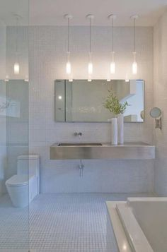white modern bathroom; floating vanity, wall mounted faucet