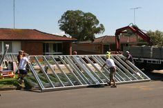 Lifting the prefabricated Boxspan chassis on site during filming of a Domestic Blitz episode for TV. This frame was used for a home extension at the rear of an existing house. Floor Framing, House Extensions, Steel Frame, Beams, Tiny House, Building A House, Studs, Solar, Home And Garden