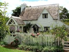 cottage with a white picket fence