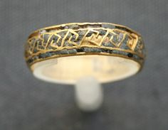 Aigina Treasure: this golden finger ring is inlaid w/lapis lazuli over which a meander pattern of gold has been made. British Museum