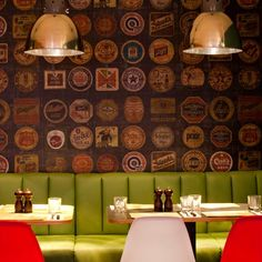 This refurbished pub and pizzeria in Bristol, England, features wallpaper decorated with beermat motifs and a bar clad with recycled wood including a door found in a skip Pub Interior, Café Bar, Pub Bar, Cafe Restaurant, Restaurant Design, Gastro Pubs, Feature Wallpaper, Hospitality Design, Commercial Interiors