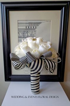 Dramatic Ivory Silk Roses Bouquet with a Brooch & Pearl Crescent finished with a stunning Black & Ivory Stripe Ribbon created by Wedding & Events Floral Design www.weddingandevents.co.uk