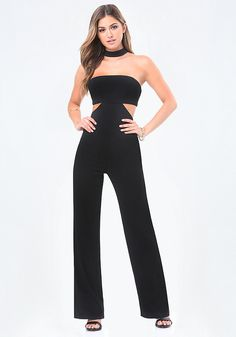 """From the bebe x Naven collection. Striking jumpsuit in a clean, modern design with a T-back extending into a sexy choker neckband. Strapless style and front-to-back waist cutout stunningly showcase skin. Convenient padded front bodice and gripper tape. Back hook-and-eye and exposed zip closures. Partially lined. An exclusive collaboration with designers Kym and Alexis McClay aka """"The Naven Twins,"""" bebe x Naven combines the bold, sophisticated style of two hot contemporary brands."""