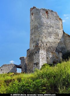 Summer view of ruined Donjon and fortification walls of The Castle of Cachtice. This castle is situated in the mountains above the Cachtice village, Trencin region, Slovakia. The Castle of Cachtice was residence of the world famous Elizabeth Bathory. This castle is definitely worth a visit.