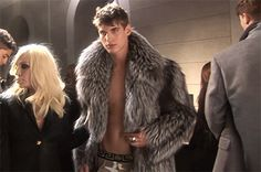 You are a male model with fur coat, and Donatella Versace rubs your fur and gives you that look