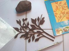 Cricut Cheating with Modeling Chocolate-    I don't have a cricut and probably will never be getting one, but every now and then I really, really wish I had one :).  I don't think they work with MC anyway, so I will just suck it up, lol. I didn't think I could freehand cut this out of chocolate so I took a CUDDLEBUG cartridge and used it as an impression matte and then cut it out with an exacto knife. The end result sort of had the same feel as cricut cut images but with more labor....but way...