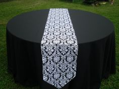 demask table runner over black table cloth- perfect :)