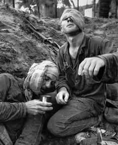Helicopter crew chief James C. Farley shouts to his crew while wounded pilot Lt. James E. Magel lies dying beside him,   Vietnam March 31, 1965.  by Larry Burrows (No more war!)