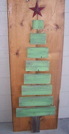con pedacitos de madera arbol de navidad