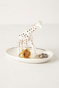 giraffe trinket dish / anthropologie...have this!! My daughter loves giraffes