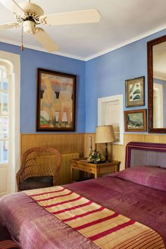 Cornflower Blue Guest Bedroom in Bedroom Design Ideas. Cornflower blue spare bedroom with large fan, wicker accessories and red bed linen. Cosy Bedroom, Guest Bedroom Decor, Guest Bedrooms, Interior Architecture, Interior Design, Headboard Designs, House Colors, Colorful Interiors, Living Spaces