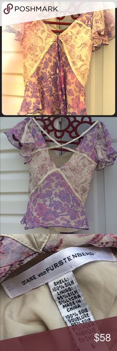 Diane Von Furstenberg Silk/Chiffon Top Like new. Chiffon paisley, with cream silk lining and detailing. Size Small/Petite. Beautiful cream colored silk, crisscrossed accents in the back. Diane von Furstenberg Tops