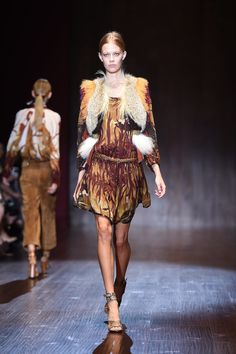 Gucci Brings Us That '70s Fashion Show: If the Gucci runway last season was all about the mod '60s, it makes sense that the fashion house has progressed to the swinging '70s for Spring 2014.