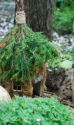 Fairy House-what a simple idea for a roof. and cedar offers protection - your fairies will love you for it!