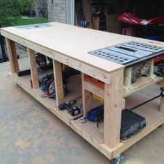 Woodworking Bench Workbench with built-in table saw and router locations. I would love for Robert to have this. - Building a nice workbench is important. Many have come up with their own approaches. Here's how to build one using basic tools. Diy Workbench, Woodworking Bench, Woodworking Crafts, Woodworking Shop, Workbench Designs, Folding Workbench, Woodworking Videos, Portable Workbench, Woodworking Equipment