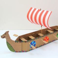 This papercraft is a simple Viking Longboat for Kids, designed by Hobbycraft. Vikings Ks2, Origami Boot, Viking Longboat, Viking Longship, Viking Party, Boat Crafts, Make A Boat, Viking Ship, Thinking Day